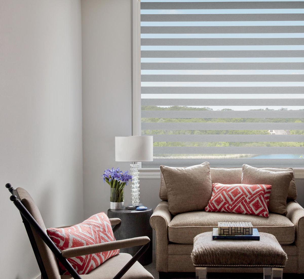 Hunter Douglas blinds in living room | West Michigan Carpet Center