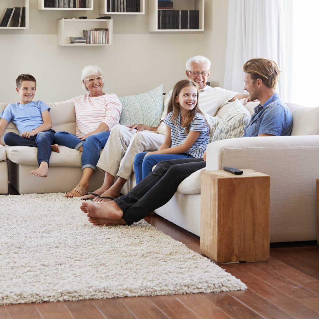 Family gosping in living room | West Michigan Carpet Center